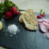 Radishes, salt, butter, bread and a tasting platter